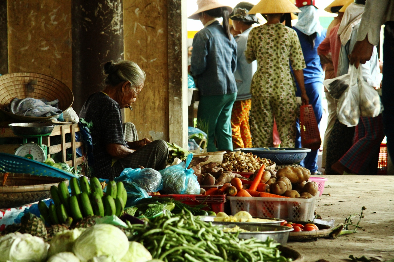 A lady watches her wares at a local market in Hue